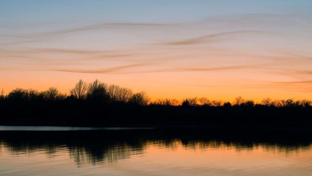Quiet early Spring sunset at Melvern Lake, Kansas ©Brad Mangas